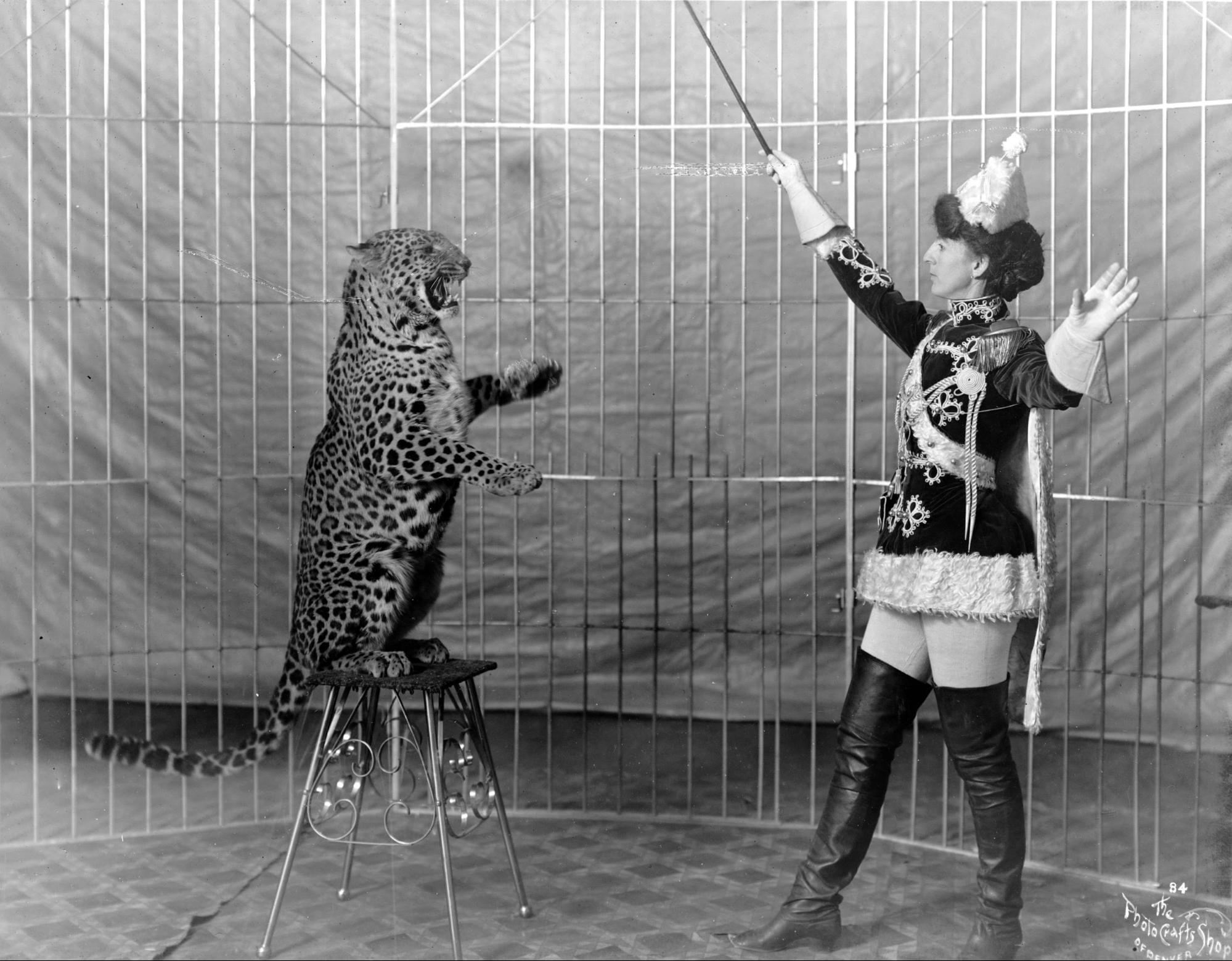 Female_animal_trainer_and_leopard,_c1906.jpg